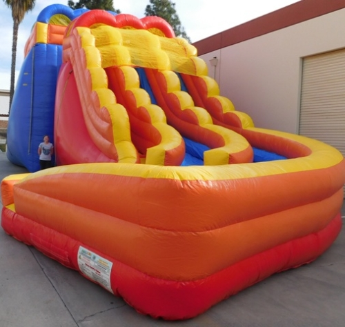 20ft Inflatable Slide with a Human next to it for comparison