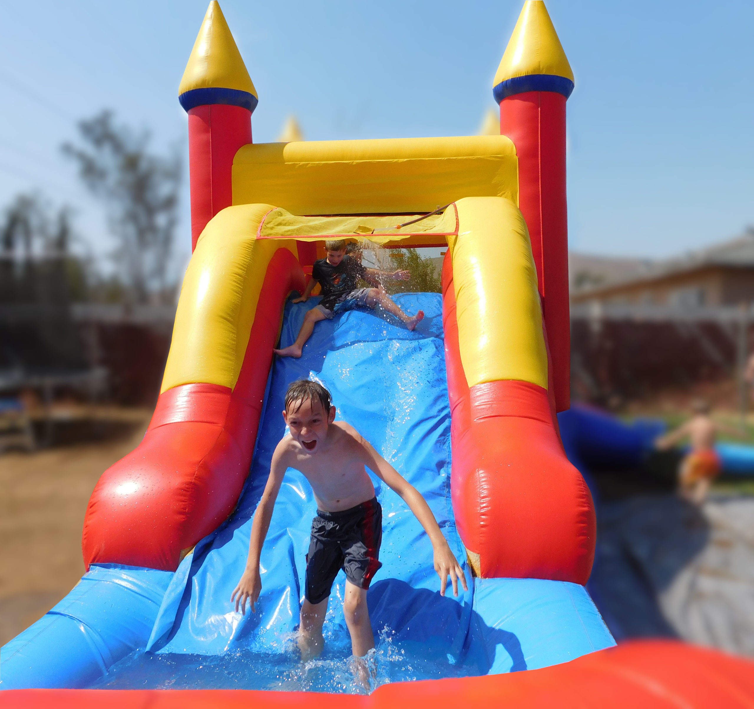 Sliding down the Inflatable Castle Combo Jumper and Slide